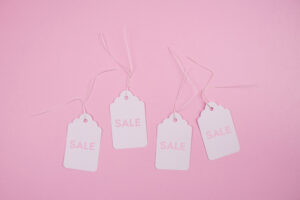 Sale tags against a pink background